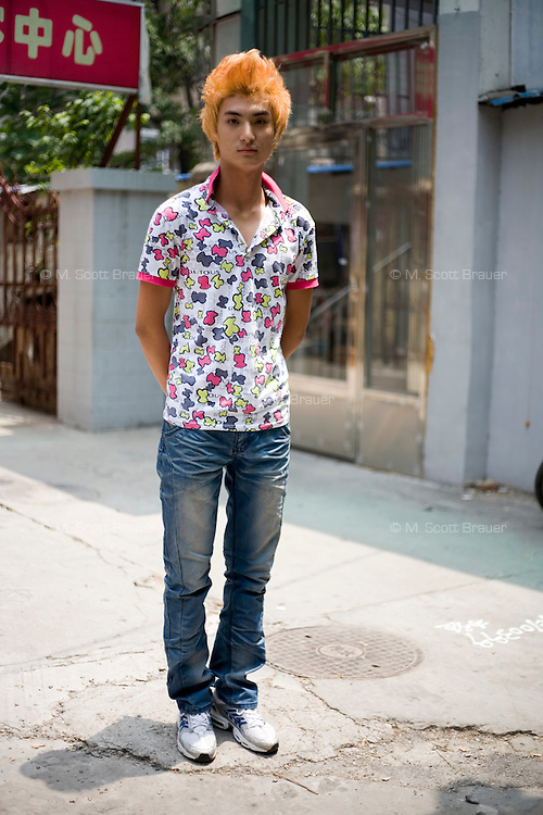 Shihailiang, a developer, age 19, poses for a portrait in Nanjing. Response to 'What does China mean to you?': 'The name of my mother country. The orientation of my being. Where I am.'  Response to 'What is your role in China's future?': 'A red envelope.' (a reference to hongbao, an envelope full of money given to youth during holidays)