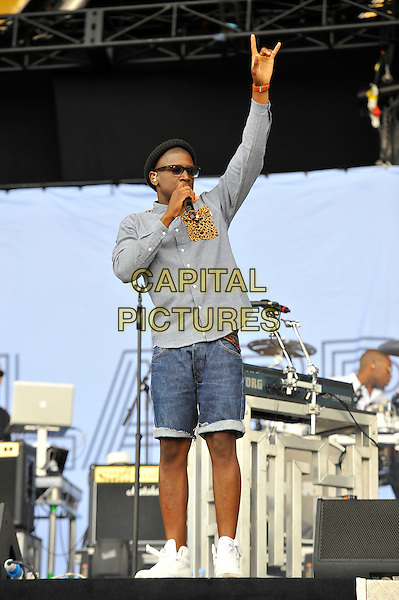 Labrinth (Timothy McKenzie).Performing at the Barclaycard Wireless Festival, Hyde Park, London, England..8th July 2012.on stage in concert live gig performance performing music full length grey gray shirt glasses hat   jean denim shorts arm in air  devil hand sign fingers gesture  leopard print pocket .CAP/MAR.© Martin Harris/Capital Pictures.