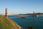 California, San Francisco: Golden Gate Bridge from the Marin Headlands, with ship pasing under the bridge..Photo #: 3-casanf78332.Photo © Lee Foster 2008