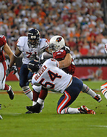 Oct. 16, 2006; Glendale, AZ, USA; Chicago Bears linebacker (54) Brian Urlacher tackles Arizona Cardinals running back (32) Edgerrin James at University of Phoenix Stadium in Glendale, AZ. Mandatory Credit: Mark J. Rebilas