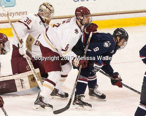 Thatcher Demko (BC - 30), Steve Santini (BC - 6), Shawn Pauly (UConn - 9) - The Boston College Eagles defeated the visiting University of Connecticut Huskies 3-2 on Saturday, January 24, 2015, at Kelley Rink in Conte Forum in Chestnut Hill, Massachusetts.