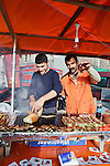 Istanbul - Turkey - 05 February 2015 -- Young entrepreneurs. -- Ferdi Esiyok,17, fish kebab seller and his father Azis, 38, grilling the fish -- PHOTO: Agata SKOWRONEK / EUP-IMAGES