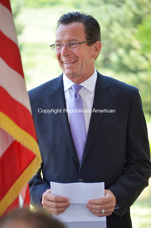 SOUTHBURY, CT- 16 July 2013 071613AP03- Governor Dannel P. Malloy smiles at supporters of the Southbury Training School Farmland Preservation Bill.<br />