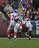 Landover, MD - November 30, 2008 -- New York Giants cornerback Aaron Ross (31) intercepts a Jason Campbell pass on the Giants 5 yard line in third quarter action against the Washington Redskins at FedEx Field in Landover, Maryland on Sunday, November 30, 2008. Antwaan Randle El (82) was the intended receiver and made the tackle at the Giants 3.  The Giants won the game 23 - 7..Credit: Ron Sachs / CNP.(RESTRICTION: No New York Metro or other Newspapers within a 75 mile radius of New York City)