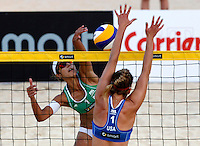 Brazil's Lili Maestrini, left, in action against April Ross, of the United States, at the Beach Volleyball World Tour Grand Slam, Foro Italico, Rome, 22 June 2013. USA defeated Brazil 2-1.<br /> UPDATE IMAGES PRESS/Isabella Bonotto