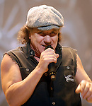 AC/DC singer Brian Johnson eyes the crowd during the band's stop at the Toyota Center Sunday Dec. 14, 2008. (Dave Rossman for the Chronicle)