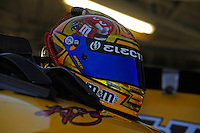 the helmet of Kyle Busch (#18) on top of his car.
