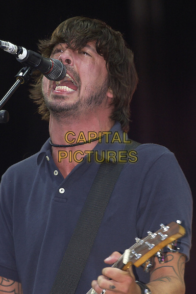 FOO FIGHTERS .V Festival.17th August 2003 .singing, stage, concert, live, music, headshot, portrait.www.capitalpictures.com.sales@capitalpictures.com.Supplied By Capital PIctures