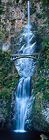914500003 panorama partially frozen multnomah falls cascades down a cliff face in fronto of a trail brigde in columbia river gorge national recreation area oregon
