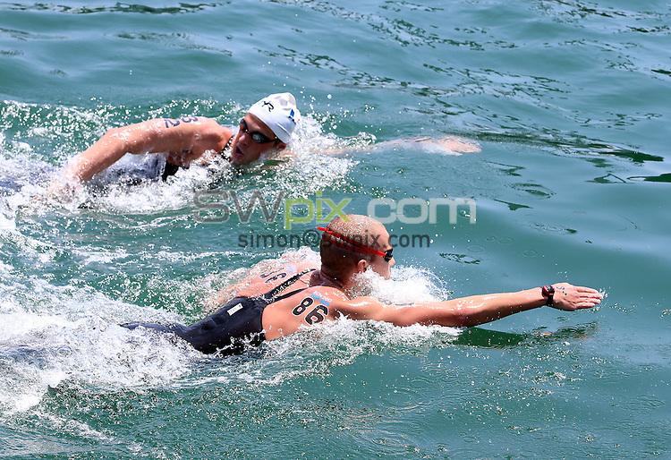 PICTURE BY VAUGHN RIDLEY/SWPIX.COM - Open Water - 15th FINA World Championships 2013 - Moll de la Fusta, Barcelona, Spain - 20/07/13 - Canada's Richard Weinberger and France's Damien Cattin-Vidal compete in the Men's 10km.