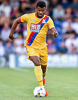 Fraizer Campbell (left) of Crystal Palace runs with the ball past Tom Beere of AFC Wimbledon, during the Friendly match between AFC Wimbledon and Crystal Palace at the Cherry Red Records Stadium, Kingston, England on 27 July 2016. Photo by Edward Thomas / PRiME Media Images.
