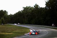 """LE MANS, FRANCE - JUNE 17: The Henn's T-Bird Swap Shop Porsche 956 103 of Jean Rondeau, John Paul, Jr., Preston Henn and Michel Ferté is driven toward the """"Indianapolis"""" corner during the 24 Hours of Le Mans FIA World Sports Car Championship race at the Circuit de la Sarthe in Le Mans, France, on June 17, 1984."""