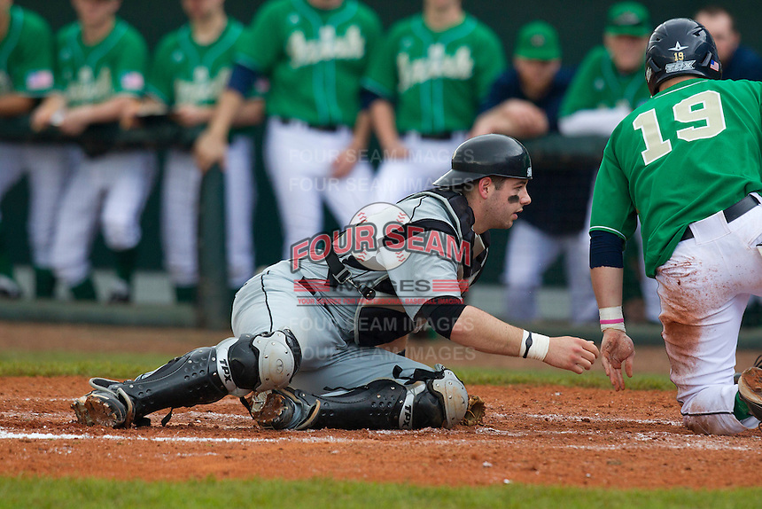 Purdue Boilermakers catcher Kevin Plawecki #26 after a collision at the plate during a game against the Notre Dame Fighting Irish at the Big Ten/Big East Challenge at Al Lang Stadium on February 19, 2012 in St. Petersburg, Florida.  (Mike Janes/Four Seam Images)
