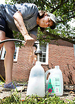 GOSHEN CT. - 08 August 2020-080820SV04-Denise Leclair of Goshen fills jugs with water at the Town Hall in Goshen Saturday.<br /> Steven Valenti Republican-American