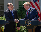 United States President Donald J. Trump, right, and President Andrzej Duda of the Republic of Poland, left, shake hands as they conduct a joint press conference in the Rose Garden of the White House in Washington, DC on Wednesday, June 12, 2019. <br /> Credit: Ron Sachs / CNP