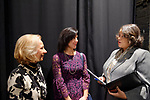 Hempstead, New York, USA. January 1, 2018. Hempstead Town Clerk SYLVIA CABANA (center), Assemblywoman MICHAELLE SOLAGES (in gray suit), and DOLORES SEDACCA talk backstage before Swearing-In ceremony at Hofstra University.