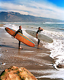 USA, California, Bolinas, surfers look at the waves before getting into the water