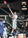 North Texas Mean Green forward Forrest Robinson (11) in action during the NCAA  basketball game between the St. Gregory Cavilers and the University of North Texas Mean Green at the North Texas Coliseum,the Super Pit, in Denton, Texas. UNT defeated St. Gregory's 81 to 52...