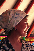 Portrait of a Nomad in her Ger - Nomadic people move from one place to another, rather than settling permanently in one location. There are an estimated 35 million nomads in the world still today. Many cultures have traditionally been nomadic but is increasingly rare in industrialized countries. Nomads in Mongolia are usually of the pastoral type following seasonally available wild plants and game - by far the oldest human subsistence method. Pastoralists raise herds, moving with them in patterns that avoid depleting pastures beyond their ability to recover.