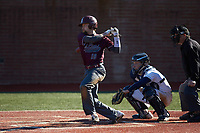 Chance Davis (18) of the Concord Mountain Lions follows through on his swing against the Wingate Bulldogs at Ron Christopher Stadium on February 2, 2020 in Wingate, North Carolina. The Mountain Lions defeated the Bulldogs 12-11. (Brian Westerholt/Four Seam Images)