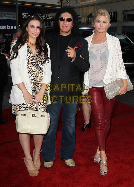 Sophie Simmons, Shannon Tweed, Gene Simmons.The L.A. Premiere of 'Ted' held at The Grauman's Chinese Theatre in Hollywood, California, USA..June 21st, 2012.full length white sheer lace jacket op black suit jacket sunglasses shades leopard print dress bag purse daughter mother mom mum father dad family couple red leather trousers.CAP/ADM/KB.©Kevan Brooks/AdMedia/Capital Pictures.