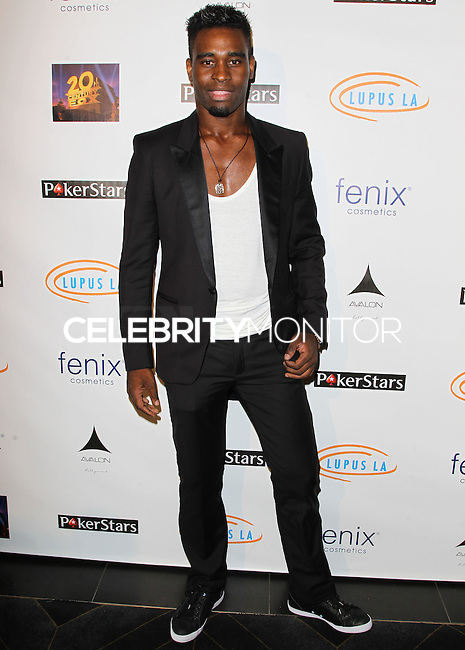 HOLLYWOOD, LOS ANGELES, CA, USA - SEPTEMBER 18: Keo Motsepe arrives at the 'Get Lucky For Lupus' 6th Annual Poker Tournament held at Avalon on September 18, 2014 in Hollywood, Los Angeles, California, United States. (Photo by Celebrity Monitor)