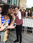SUNRISE, FL - DECEMBER 21: Musicians Charley Bagnall of the band Rixton pose with fans backstage at Y100's Jingle Ball Village, Y100's Jingle Ball 2014 official pre-show at BB&T Center on December 21, 2014 in Sunrise, Florida.  (Photo by Johnny Louis/jlnphotography.com)