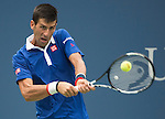 Novak Djokovic (SRB) defeats Joao Sousa (BRA) 6-1, 6-1, 6-1