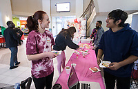 Bayley Gober (left), a student from Fayetteville, talks to Tarun Eisen (left) of Rogers, a student in Sigma Kappa Delta English Honor Society, after decorating a cookie Thursday, Feb. 13, 2020, during the Student Ambassador and Government Association's Valentine's Cookie Day at Northwest Arkansas Community College in Bentonville. Check out nwaonline.com/200214Daily/ for today's photo gallery.<br /> (NWA Democrat-Gazette/Ben Goff)