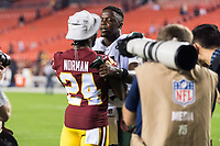 Landover, MD - August 16, 2018: Washington Redskins defensive back Josh Norman (24) and New York Jets quarterback Teddy Bridgewater (5) talk after their preseason game at FedEx Field in Landover, MD. (Photo by Phillip Peters/Media Images International)