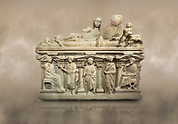 "Roman relief sculpted sarcophagus of Aurelia Botiano and Demetria depicted reclining on the lid, 2nd century AD, Perge Inv 1.35.99. Antalya Archaeology Museum, Turkey.<br /> <br /> it is from the group of tombs classified as. ""Columned Sarcophagi of Asia Minor"". The lid of the sarcophagus is sculpted into the form of a ""Kline"" style Roman couch on which lie Julianus &  Philiska. This type of Sarcophagus is also known as a Sydemara Type of Tomb.. Against a warm art background."