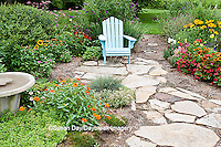 63821-206.14  Blue chair and birdbath in garden with Red Dragon Wing begonia (Begonia x hybrida), Autumn Colors Black-eyed Susans (Rudbeckia hirta 'Autumn colors'), Snapdragons (Antirrhinum),  Blue Victoria Salvia (Salvia farinacea), Indian Summer Rudbeckia (Rudbeckia hirta 'Indian Summer'), Zinnias, Sedums, Pentas, Butterfly Bush (Buddleia davidii), Marion Co. IL