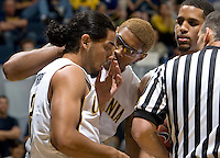 Robert Solomon of California checks on Jorge Gutierrez's eyes after being hit by San Diego player during the game at Haas Pavilion in Berkeley, California on November 1st, 2011.  California defeated San Diego, 88-53.