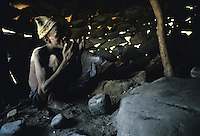 The blacksmith moistens his hands so it is easier for him to grip the mallet.