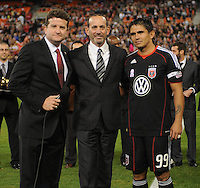 DC United forward Jaime Moreno (99) right with MLS commissioner Don Garber (middle) and sports broadcaster Dabe Johnson (left) at the presentation for Jaime Moreno last game .  Toronto FC. defeated DC United 3-2 at RFK Stadium, October 23, 2010.
