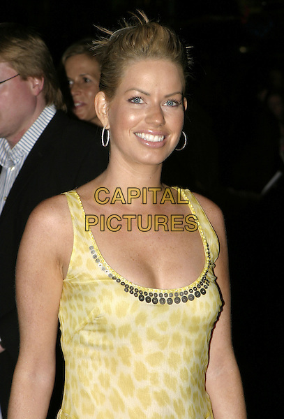 CAROLINE STANBURY.Collateral UK premiere, UCI Empire, Leicester Square, London, 2nd September 2004..half length yellow leopard print ruffle dress.Ref: AH.www.capitalpictures.com.sales@capitalpictures.com.©Capital Pictures.