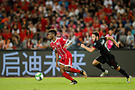 Bayern Munich Forward Kingsley Coman (L) plays against AC Milan Midfielder Hakan Calhanoglu (R) during the 2017 International Champions Cup China match between FC Bayern and AC Milan at Universiade Sports Centre Stadium on July 22, 2017 in Shenzhen, China. Photo by Marcio Rodrigo Machado/Power Sport Images