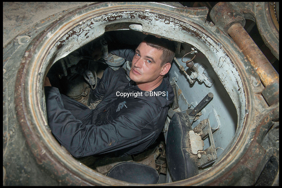 BNPS.co.uk (01202 558833)<br /> PIc: LauraDale/BNPS<br /> <br /> Workshop technicians Brian Frost (39) sitting inside 'Fury'.<br /> <br /> Meet the real driving force behind Brad Pitt's new Second World War blockbuster, Fury.<br /> <br /> Tank mechanics Brian Frost, 39, and Ian 'Buzz' Aldridge, 53, were hired to drive the famous Sherman tank the movie is named after for most of the major scenes.<br /> <br /> The pair, who work at Bovington Tank Museum in Dorset, spent six months taking it in turns to operate the 26 ton tank in front of the cameras.<br /> <br /> Although the two never appear in the movie, every time 'Fury' is seen in motion and without actor Michael Pena in the driving seat,<br /> Brian or Buzz are at the controls.<br /> <br /> The pair also trained actor Pena the basics of driving the Sherrman tank to give the close-up shots of his character Corporal Trini 'Gordo' Garcia more legitimacy.<br /> <br /> The museum lent the movie's producers their M4 Sherman tank to act as Fury as well as the services of Brian and Buzz.