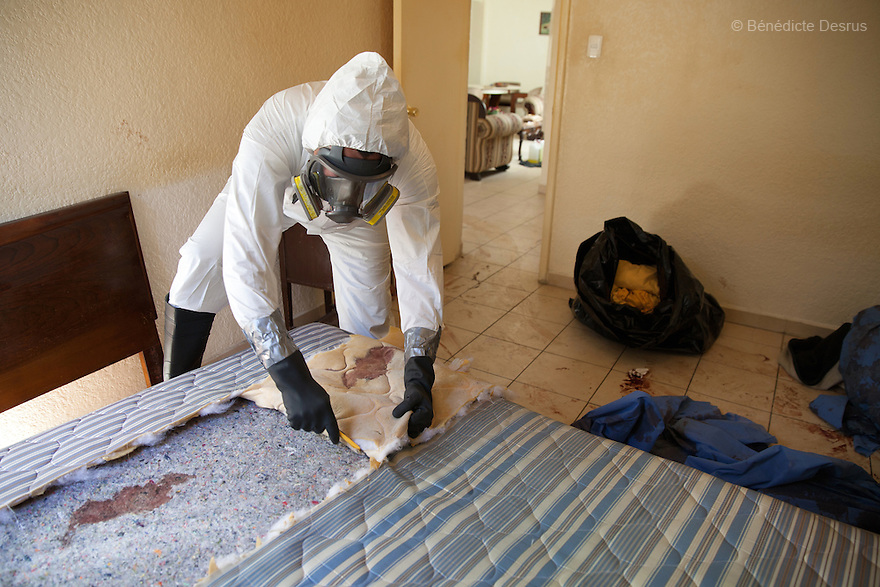 """Donovan carries out a forensic cleaning in Mexico City, Mexico on January 14, 2016. The decomposed body of a man in his 50s was found on the floor of his mother's bedroom, days after he had died of an intestinal obstruction. Because of her physical disability, the mother of the deceased – who had been her caregiver – was unable to move enough to make an emergency call. As a consequence, she was trapped in the room for three days with the body of her son – and without food or water - before help arrived. Donovan Tavera, 43, is the director of """"Limpieza Forense México"""", the country's first and so far the only government-accredited forensic cleaning company. Since 2000, Tavera, a self-taught forensic technician, and his family have offered services to clean up homicides, unattended death, suicides, the homes of compulsive hoarders and houses destroyed by fire or flooding. Despite rising violence that has left 70,000 people dead and 23,000 disappeared since 2006, Mexico has only one certified forensic cleaner. As a consequence, the biological hazards associated with crime scenes are going unchecked all around the country. Photo by Bénédicte Desrus"""