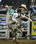 Kody Lostroh celebrates his complete ride with the rodeo clown.  Photo by Tom Smedes.
