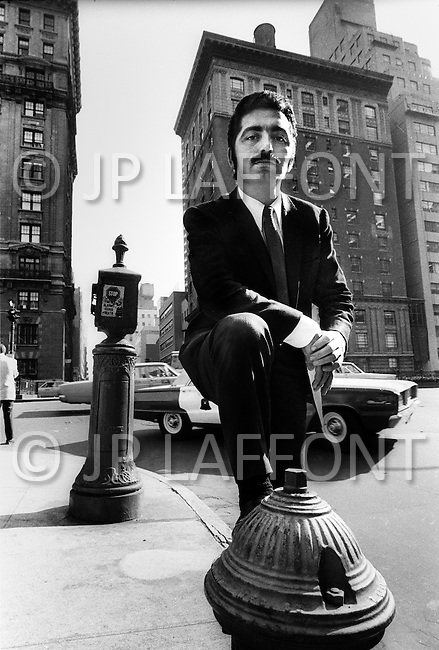 New York City. October, 1966. Paco Rabanne presenting his collection for the first time in NYC, posing on Park Avenue at 60th Street.