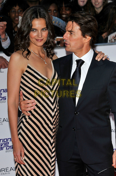 KATIE HOLMES & TOM CRUISE.National Movie Awards at The Royal Festival Hall, London, England 26th May 2010.half length pink beige striped stripes dress suit jacket arm over shoulder around waist married husband wife tall short profile .CAP/PL.©Phil Loftus/Capital Pictures.