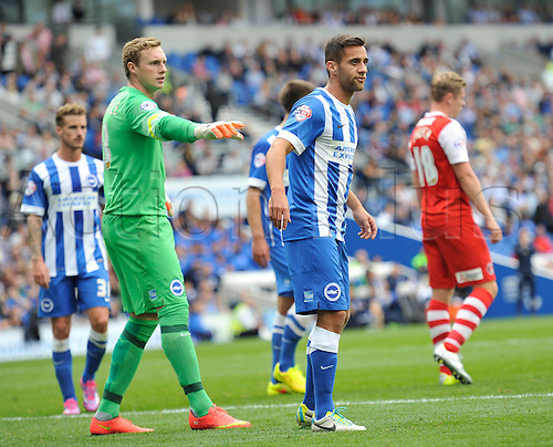 30.08.2014.  Brighton, England. Sky Bet Championship. Brighton and Hove Albion versus Charlton Athletic. Brighton's David Stockdale gives defender Sam Baldock placement instructions