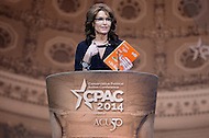 National Harbor, MD - March 8, 2014: Sarah Palin, former governor of Alaska, holds a Dr. Seuss book as she recites a humorous political poem on the final day of the 2014 Conservative Political Action Conference held at National Harbor, MD March 8, 2014.   (Photo by Don Baxter/Media Images International)