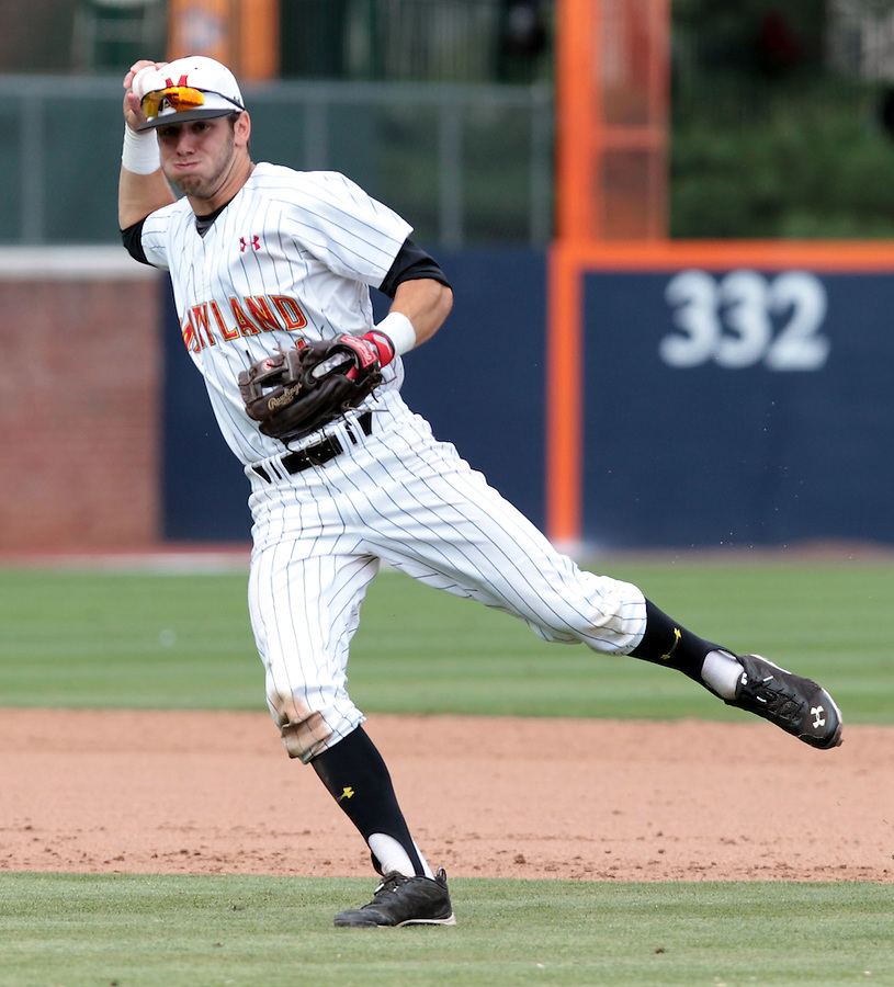 Maryland shortstop Blake Schmit (1) throws to first base for an out in the eighth inning of an NCAA college baseball tournament super regional game in Charlottesville, Va., Sunday, June 8, 2014. Virginia defeat Maryland 7-3. (AP Photo/Andrew Shurtleff)
