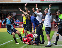 Lewis Young of Crawley Town  slides in on Gareth Ainsworth Manager of Wycombe Wanderers during the Sky Bet League 2 match between Crawley Town and Wycombe Wanderers at Checkatrade.com Stadium, Crawley, England on 29 August 2015. Photo by Liam McAvoy.