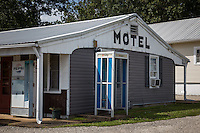 Vernelle's Motel was built in the late 1930s by E.P. Gasser. Originally called Gasser Tourist Court, the business -- consisting of six cabins, a filling station and a novelty shop -- changed hands in the early 1950s, when E.P. Gasser's nephew, Fred, and his wife, Vernelle, bought the property and expanded it.<br /> <br /> The new Vernelle's, named for its proprietress, was quite a complex. Besides the motel, the property -- pictured on the vintage postcard above -- included a restaurant serving steaks, fried chicken, shrimp and other delicacies to refresh hungry travelers. At one time, there was a petting zoo on the grounds as well.<br /> <br /> In 1957, the restaurant was torn down and the motel moved a few feet north to accommodate the widening of Route 66 to four lanes. The motel remains today, along with its original sign, which got a fresh coat of paint last year thanks to the efforts of the Route 66 preservation group Friends of the Mother Road.