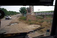 """REPUBLIC OF MOLDOVA, Gagauzia, Vulcanesti, 2009/07/1..At the entrance of Vulcanesti, the sign of an old Soviet-era collective farm dedicated to Lenin: """"Bourlatcheni. Moldova became independent in 1991 and the Gagauz got its autonomous in 1994..© Bruno Cogez / Est&Ost Photography..REPUBLIQUE MOLDAVE, Gagaouzie, Vulcanesti, 1/07/2009..A l'entrée du village de Vulcanesti, trône l'enseigne d'un ancien kolkhoze de l'époque soviétique dédié à Lénine : """"Bourlatcheni"""". La Moldavie est devenue indépendante en 1991 et la Gagaouzie autonome en 1994..© Bruno Cogez / Est&Ost Photography"""