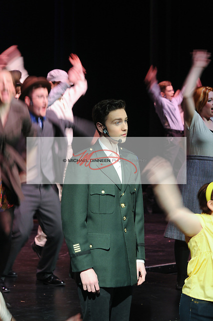 CHS' Eric Rueb as Conrad Birdie surrounded by cast members in a dance number.