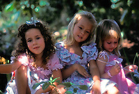 Little girls all dressed up and posing for a picture